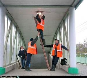 idiots freestanding a ladder in use